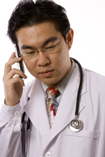 Asian Doctor With Phone